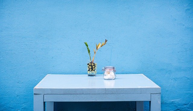 A blue vase on a table