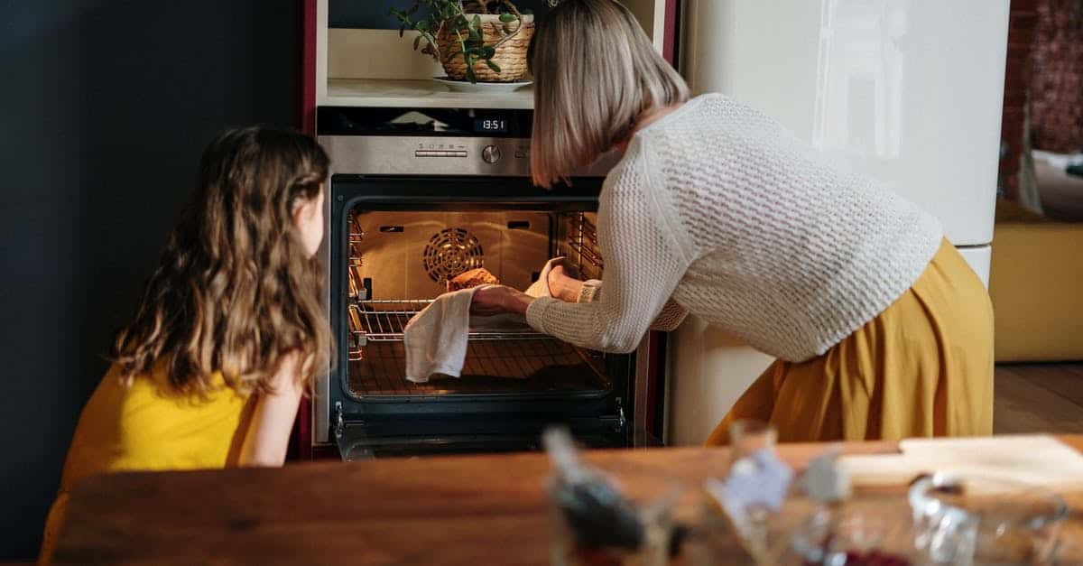 A person looking into the oven