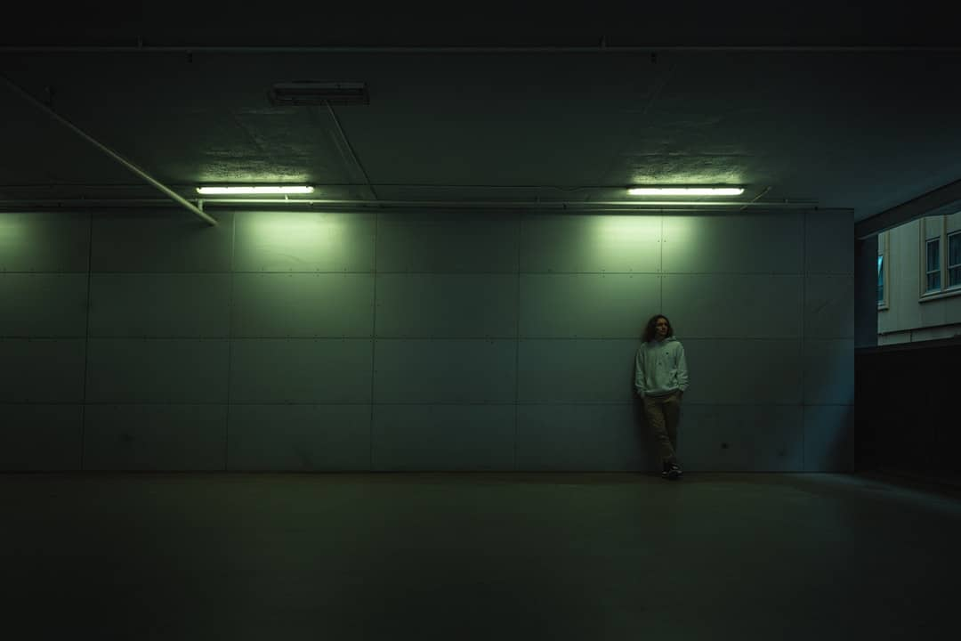 A person standing in a dark room