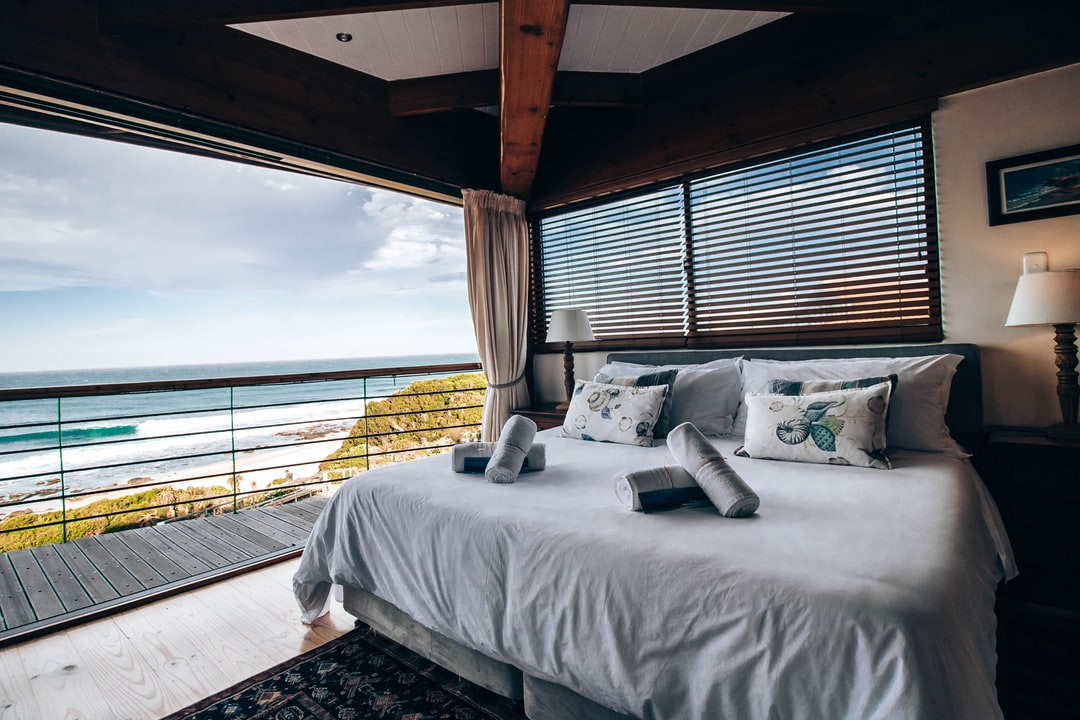 A bedroom with a large bed sitting next to a window