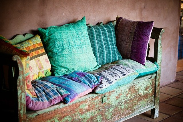 A green sofa in a room