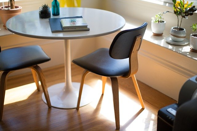 A desk with a chair and a table